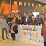 Familles syriennes et jeunes St Egidio derriere banderolle